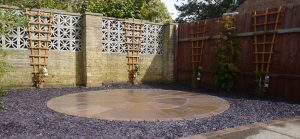 sandstone patio, 2 ring patio, sandstone,gardendesign, circular patio, purple slate, Yarm, Darlington, Green Onion Landscaping, Teesside, landscapers, landscaping, cobbled edging, planting, soft landscaping, gardens, trellis, Stockton, Wynyard, Middlesbrough, Andy Smith,