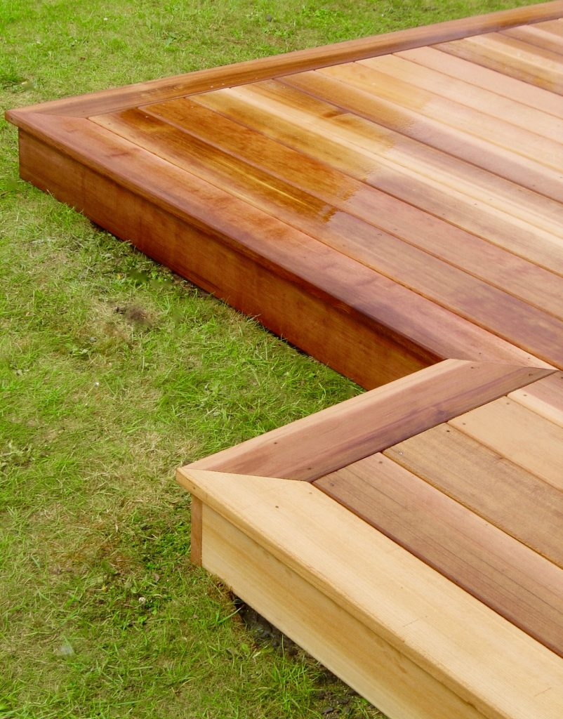 Cedar wood garden decking for Images of garden decking