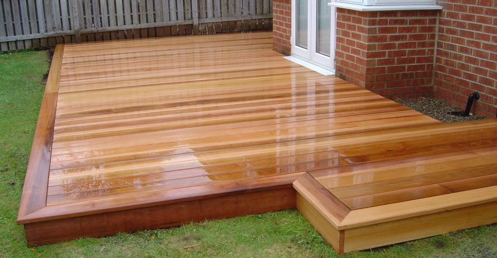 Cedar wood garden decking in darlington green onion for Images of garden decking