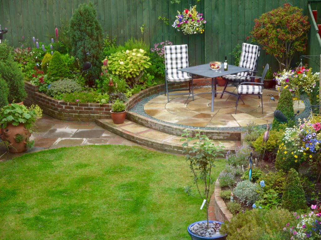 Patios,Paving,Raised Sandstone Patio,Steps,Garden Design,Landscapers, Teesside,Darlington,Middlesbrough, Fairfield, County Durham, North Yorkshire, landscape design, circular patio, 3 ring patio,