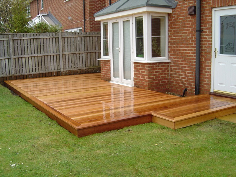 Cedar wood garden decking in darlington green onion for Garden decking ideas uk