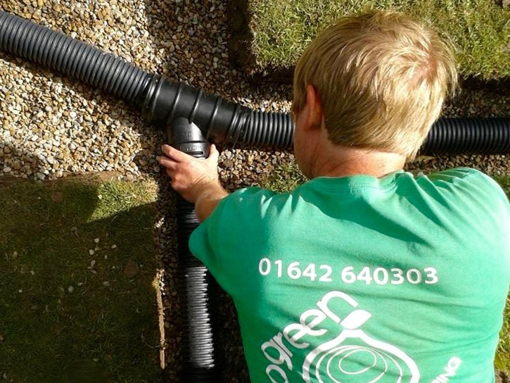 Garden drainage solutions, drainage, land drains, flood drains, sump holes, drainage pipes, under ground, lawn, flooding, soggy lawn, water holding, french drain system, spider network system, water logged lawn, Green Onion landscaping, Stockton, Teesside, County Durham, North east, North Yorkshire,solving garden drainage problems