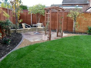 turfing, gravel,decking, walls, brick work, stockton, landscaping, Fairfield,sandstone patio, patio, curved edges, romantic garden, garden design, Darlington, Middlesbrough