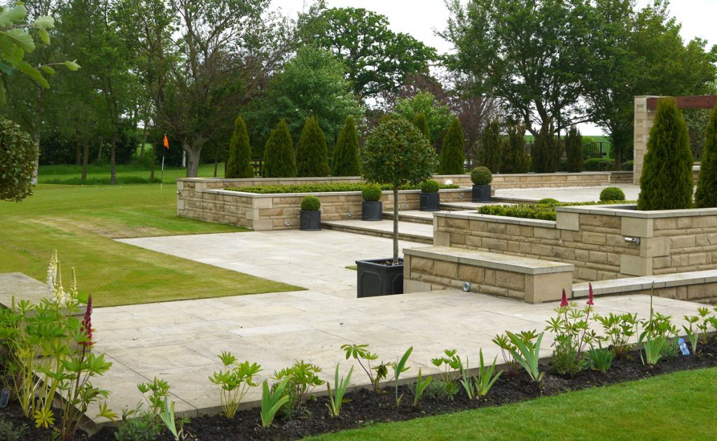landscape design, landscape gardening, landscapers, gardeners, creative design, Teesside, patios, paving, sandstone, pots, Holly, garden walls, raised patio area, pergola, turfing, borders, plants, soft landscaping, hard landscaping, Green Onion Landscaping,