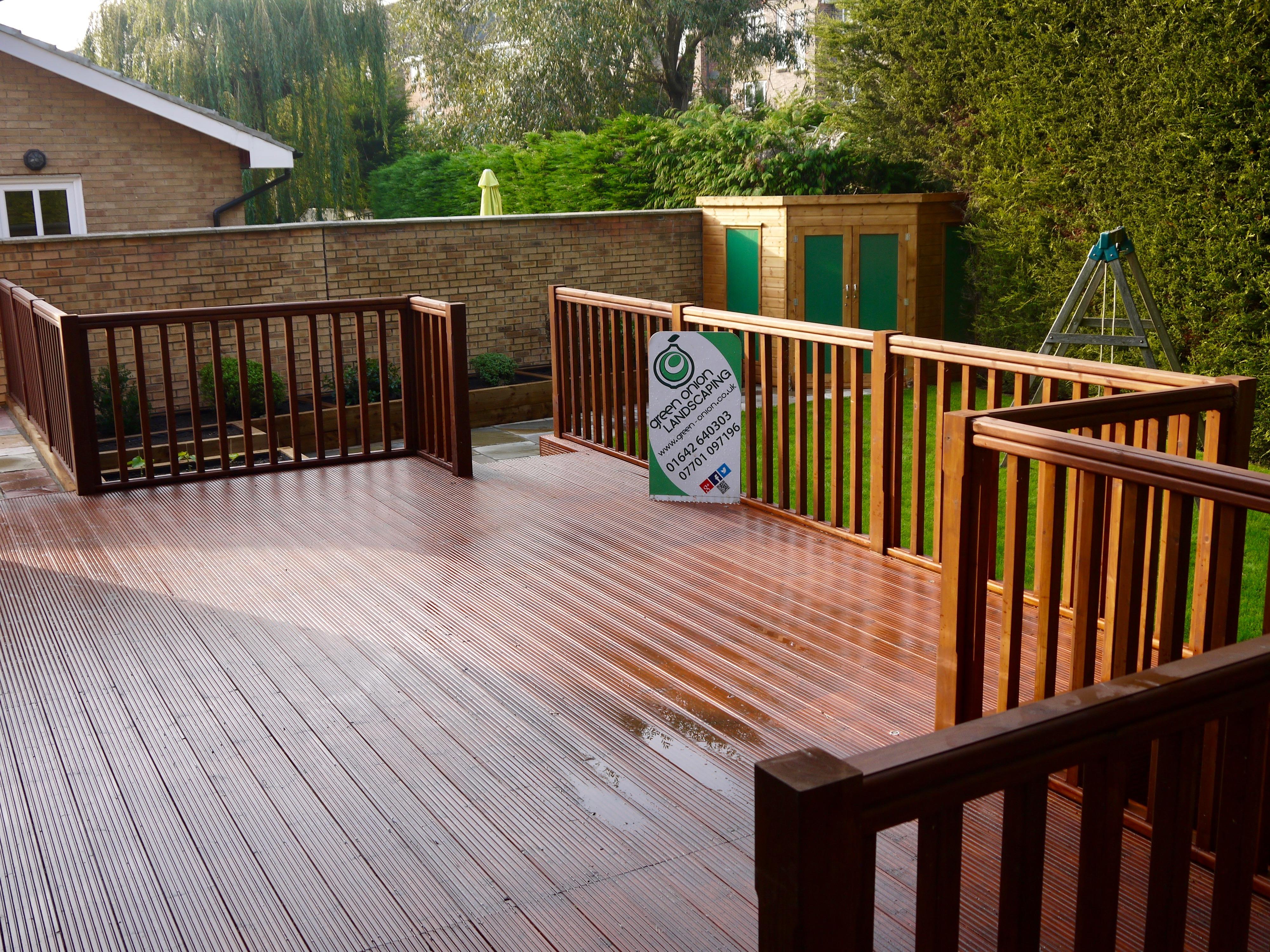 Raised decking storage garden landscaping green onion for Garden decking middlesbrough