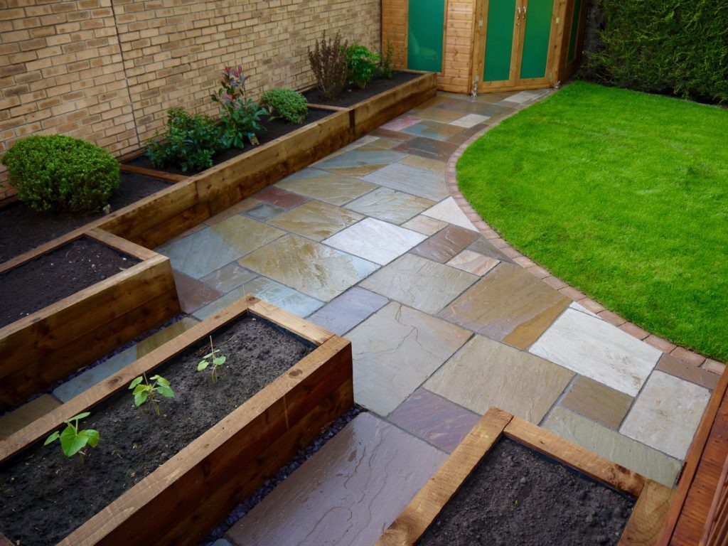 Design Green Landscapes: Low-maintenance-gardens-Raised-sleepers-sandstone-patio