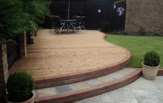Curved Decking, Decking, Brick wall, steps, sandstone paving, Ingleby Barwick, Green Onion Landscaping,Landscapers, decking specialists